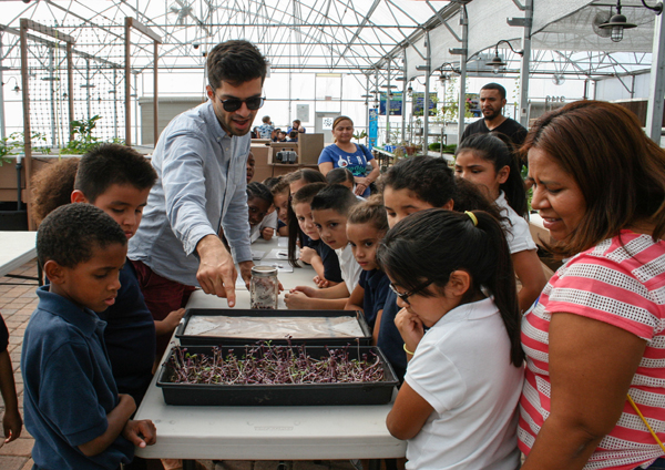 A classroom visit to Brook's Academy Greenhouse at Roosevelt School District, where local vendor Arizona Microgreens is leasing space to grow their produce.-resize