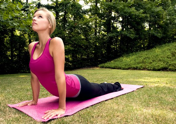 Beautiful nice looking girl practicing yoga poses