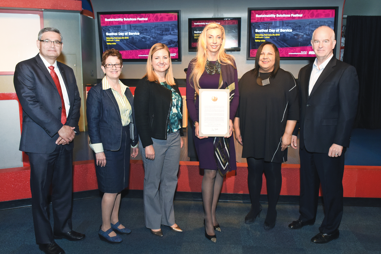Phoenix City Councilwoman Kate Gallego presents a Mayoral Proclamation to Melani Walton as part of the 2016 Sustainability Solutions Festival. From left: John Trujillo, Executive Director of City of Phoenix Public Works; Patricia Reiter, Executive Director of ASU Walton Sustainability Solutions Initiatives; Phoenix Councilwoman Kate Gallego; Melani Walton; Chevy Humphrey, President and CEO of Arizona Science Center; and Gary Dirks, Executive Director of ASU Julie Ann Wrigley Global Institute of Sustainability. Photo by Tim Trumble, courtesy of ASU Walton Sustainability Solutions Initiatives.