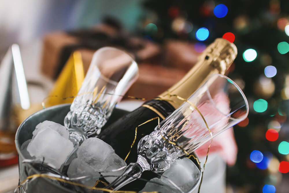 champagne and glasses in ice bucket